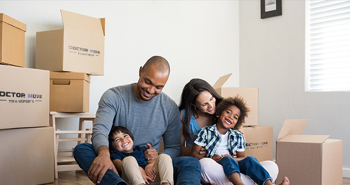 Happy family surrounded by boxes of Doctor Move Transports